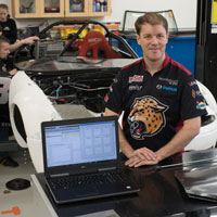 Tyler Stover, a new faculty member in IUPUI's motorsports engineering program, displays Dymola simulation software. Digital advances keep his students busy when they can't get on the racetrack. Photo by Chris Meyer, IU Communications